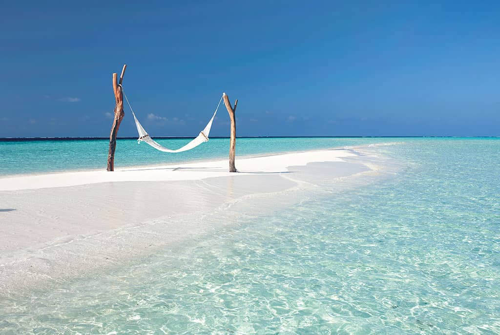 Beach hammock at Constance Moofushi Resort, Maldives