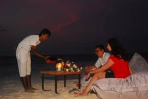 Romantic evening on the beach at Constance Moofushi