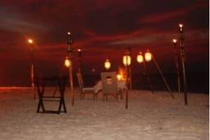 Private dinner setting on the beach