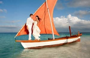 Wedding couple on a boat at Constance Moofushi