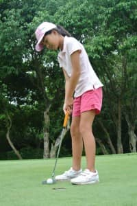 Girl playing golf at Constance Belle Mare Plage