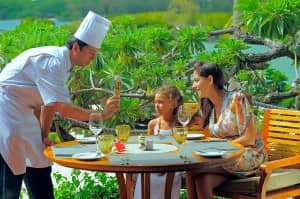 Chef serving family at Constance Hotels