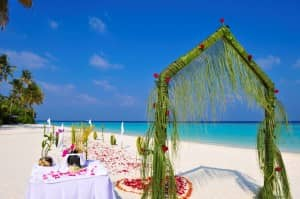 Wedding arch on the beach at Constance Halaveli Resort, Maldives
