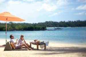 Couple enjoying luxury beach holiday at Le Prince Maurice