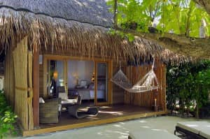 Beach villa at Constance Moofushi Resort, Maldives