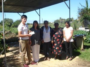 Matt Balmer and family presenting charity donation to Centre Joie de Vivre, Mauritius
