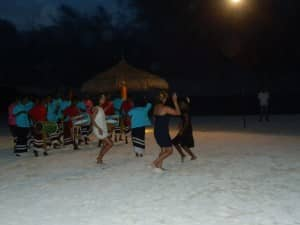Guests beach dancing at Constance Moofushi, Maldives