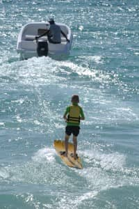 Children's water skiing at Constance Belle Mare Plage, Mauritius