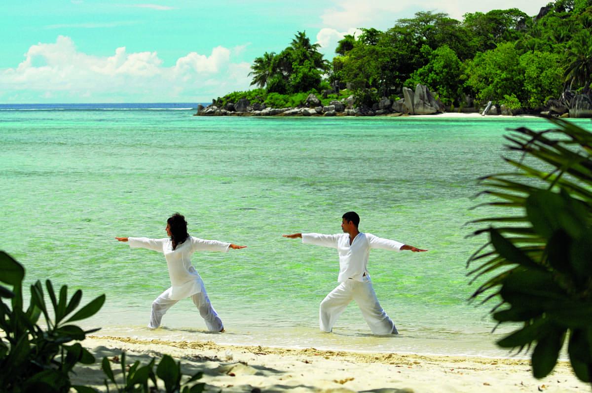 Beach yoga at Constance Ephelia, Seychelles