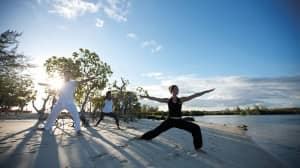 Yoga on the beach at Constance Le Prince Maurice