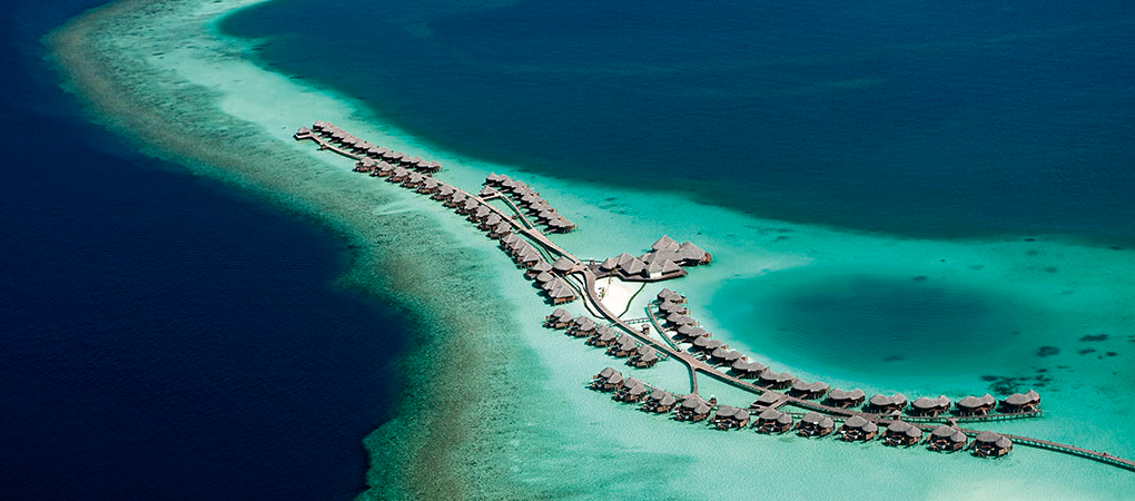 An aerial view of Constance Halaveli's water villas