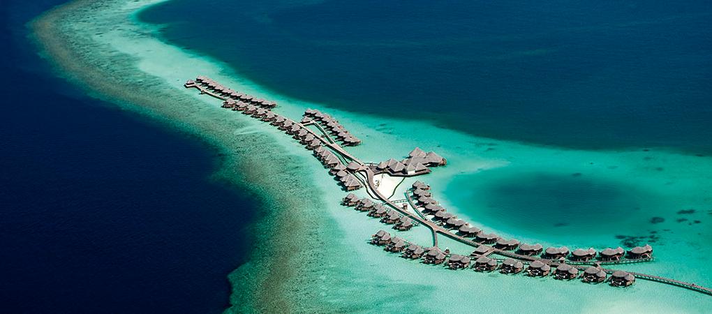 An aerial view of Constance Halaveli's water villas