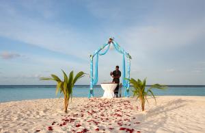 Preparing for a beach wedding in the Maldives