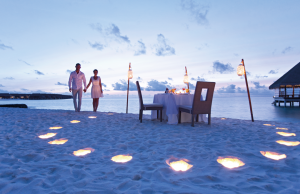 Enjoy a romantic meal with the sand between your toes