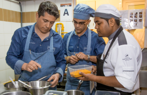 Michelin-starred chef, William Frachot, working with his team mate