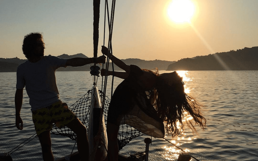 Alessandra Grillo on a boat at sunset