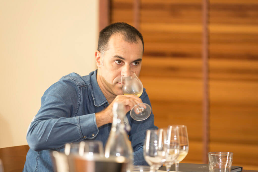 Chef Frederic smelling his wine