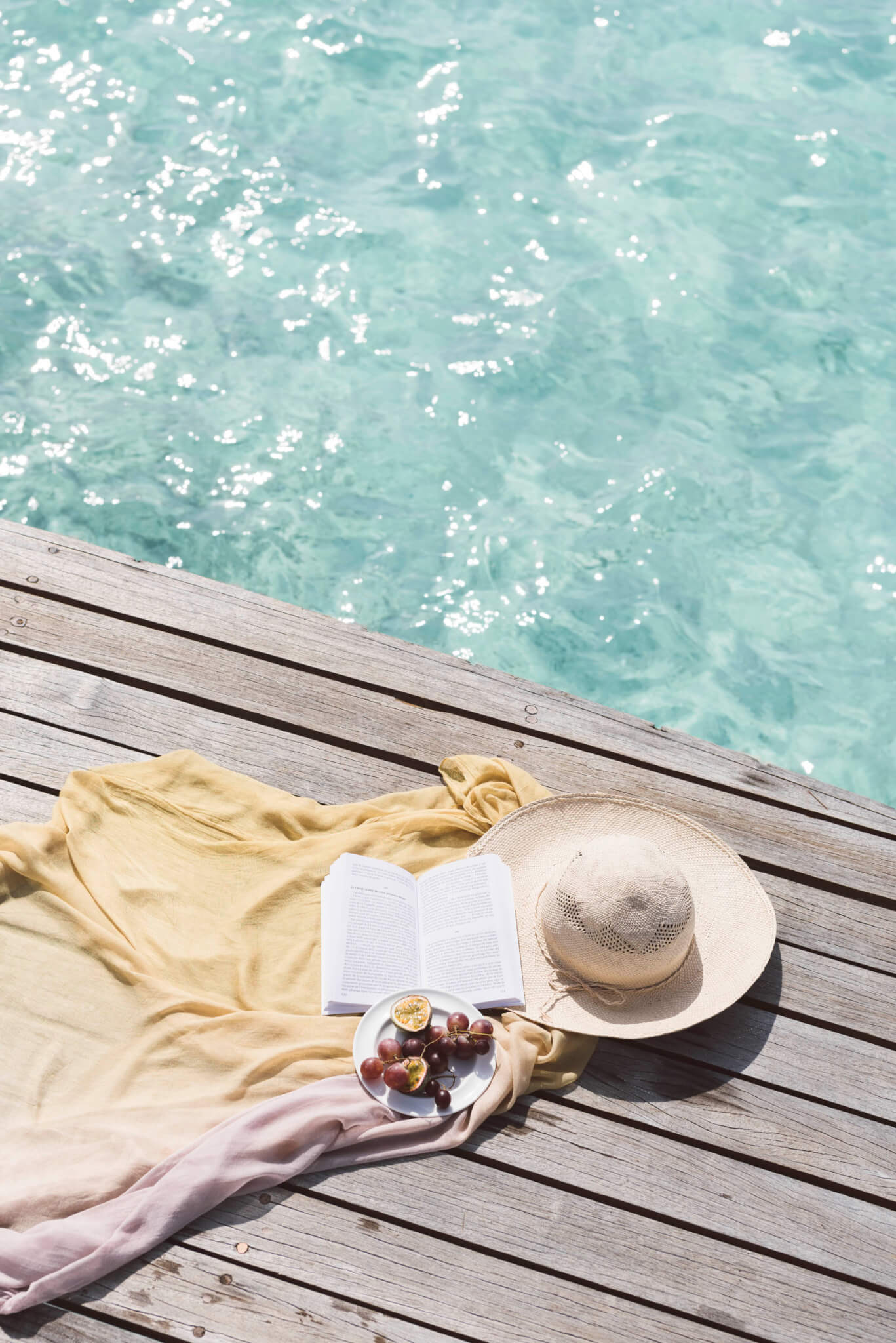 Reading by crystal clear waters