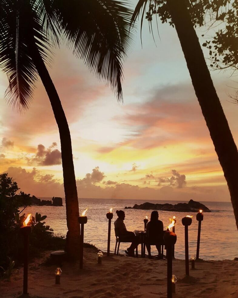 Romantic sunset dinner at Constance Ephelia Seychelles