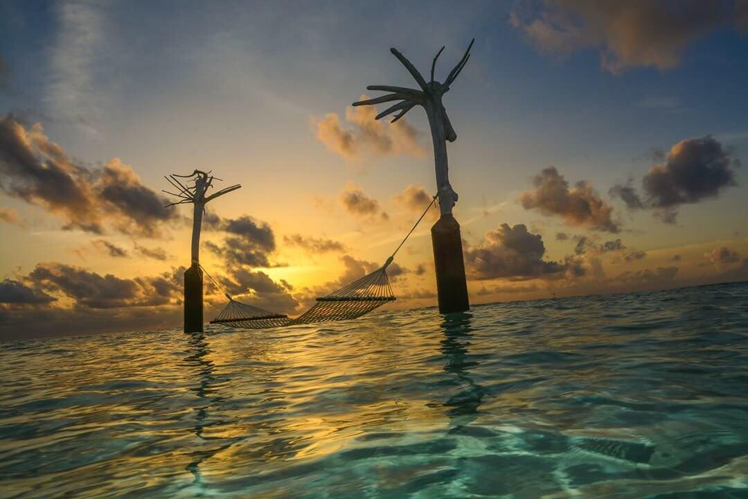 Sunset over the sea hammock Constance Moofushi Maldives