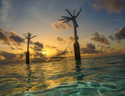 Sunset over the sea hammock Constance Moofushi Maldives