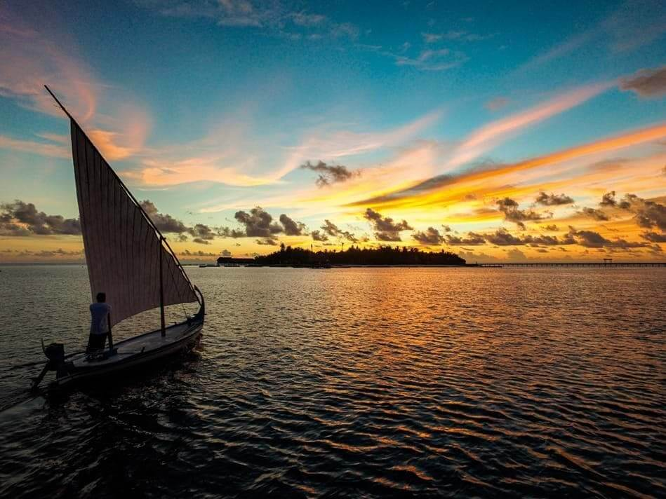 Sunset dhoni sailing